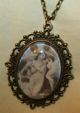 New listing Lovely Picot Rimmed Brasstone Glass Gathering of Angels Cherubs Cameo Necklace
