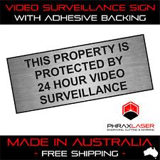 24HR VIDEO SURVEILLANCE - SILVER SIGN - LABEL - PLAQUE w/ Adhesive 100mmx40mm