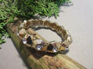 Gold Tone Metal Stretch Bangle Bracelet with Clear Rhinestones