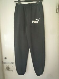 Puma track suit bottoms. Black. Age 13 = 14 years. Inside leg 27 inches
