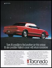 Oldsmobile Toronado print ad 1990 red car starry background