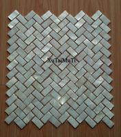 White herringbone shell mosaic mother of pearl tile bathroom kitchen backsplash