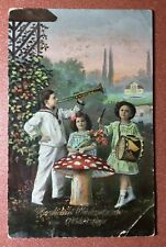 Antique photo postcard 1910s Children musical instruments. Mushroom amanita
