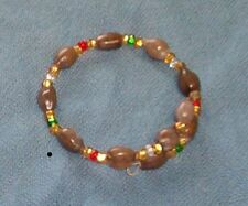 Bracelet: Brown Hawaiian Job's Tears and silver lined seed beads gold red green