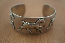 STERLING SILVER RUNNING HORSES WIDE CUFF BRACELET.