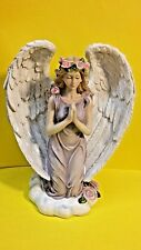 Angel figurine praying