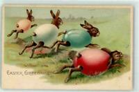 ~Bunny Rabbits Dressed In Colored Eggshells~Running~Antique~Easter Postcard-p901