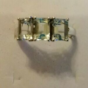 Sterling silver ring with three good sized cut aquamarine stones size R/S
