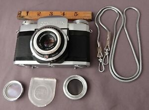 Early Zeiss Ikon Contaflex 35mm film SLR with Pentar 45mm f2.8, chain & filters