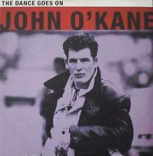 """JOHN O'KANE - THE DANCE GOES ON 7"""" VINYL 1990s POP ROCK NM/NM"""