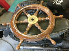 Wooden and brass ships wheel and boss.