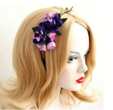 Ladies headband with purple & pink floral arrangement - good quality! Well made.