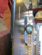 Armitron Diamond Now Women's Watch Silver & Gold Band, Blue Green Face