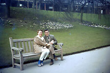 Vintage Agfacolors Slide Negative, A smiling couple sitting on a bench in a park
