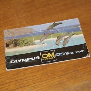 Booklet OLYMPUS OM SYSTEM MANUAL for MOTOR DRIVE GROUP leaping dolphins on cover