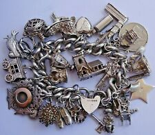 Huge vintage solid silver charm bracelet & 33 charms, rare,open.move, 171.5g