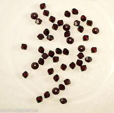 50 perles  toupies en cristal de Swarovski  5328 Garnet (rouge foncé) 3 mm