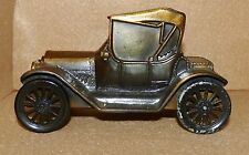 """Metal (Copper Look) 1915 Old Car Bank Copyright 1974 with Movable Wheels 5 1/4""""L"""