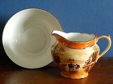 An Art Deco Porcelain Milk Jug and Sugar Bowl by Victoria China