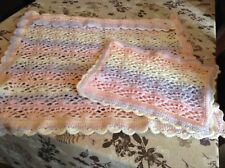 A new hand crochet pram cover @ pillow  case rainbow colours