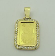 24KT 5 GMS PURE YELLOW GOLD WITH 14KT 8.18 GMS STUDDED BORDER WITH 1.08 CARATS.