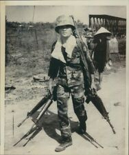 1972 Press Photo Vietnam War Soldier Carrying Multiple Guns