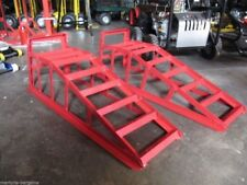 A set of 2T car ramps 1T per ramp weight capacity Colour red