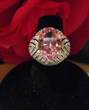 Silver tone ring with large Kunzite (pink) stone flanked by lots of clear CZ's