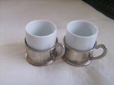 Ensemble de 2 tasses en porcelaine blanche à supports en métal argenté