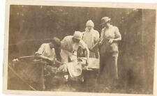 Veterinary Vet Doctor Nurse Over Dog Holding Saw Perform Amputation? 1910s Photo