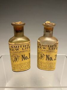Two Antique Smiths New Life Colic Remedy Bottles Paper Labels Apothecary
