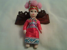hand-made porcelain & cloth doll key-Ring with pink head-wear, red costume