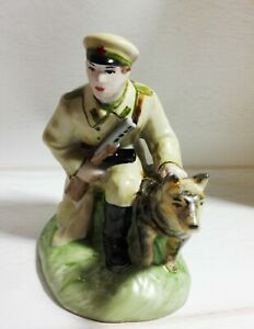 Porcelain vintage figurines Military man with a dog Figurine Soviet propaganda