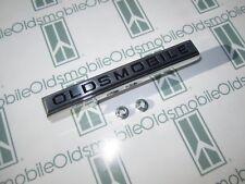 "1967 Olds Cutlass, Cutlass Supreme Grill Bar Emblem with Hardware | ""Oldsmobile"""