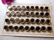 Ancienne plaque de 36 boutons en verre noir et doré diamètre: 1,3 cm