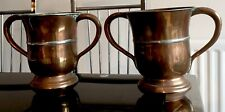 More details for antique pair of large copper tankards twin handles silver banded pewter filled