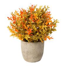 Fiori e piante finte in vaso rossi per la decorazione della casa