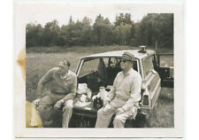 2 MEN ON STATION WAGON TAILGATE, CAMERA ON TOP OF CAR, SNAPSHOT PHOTO