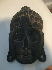 buddha ornament mask wood carved Balinese spa style interior