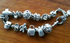 Very Good  Sterling Silver Slider Charm Bracelet with 13  Charms & 8 Spacers