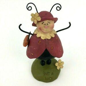 B.Lloyd LadyBug with a Purse Spring Figurine
