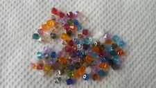 100 GENUINE SWAROVSKI 4MM 5301/5328 XILION CRYSTAL BEADS ASSSORTED COLORS.