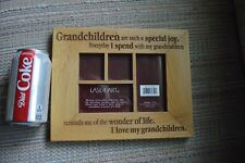 Picture frame designed for multiple pictures of Grand father's grand children