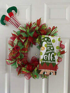 Deco mesh wreath with elf surveillance  red and green mesh with coordinating rib