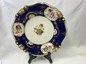 Antique Plate Decorated With Panels of Flowers Within A Blue Band 26cm