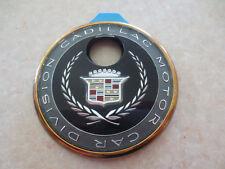 Original 1990s Cadillac automobile trunk keyhole badge