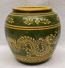 Earthenware water jar dragon designgreen and yellow Thailand