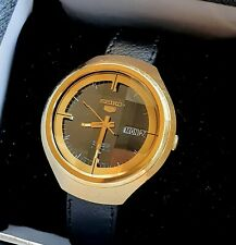Seiko 6319 7010. Gold, faceted glass. 21 jewel automatic. December 1977