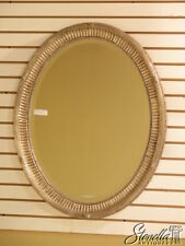 L39723: FRIEDMAN BROTHERS Oval Silver Decorator Mirror