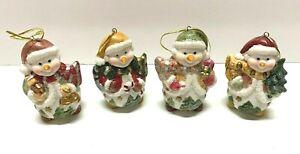Lot of 4 happy ceramic snowmen Christmas ornaments